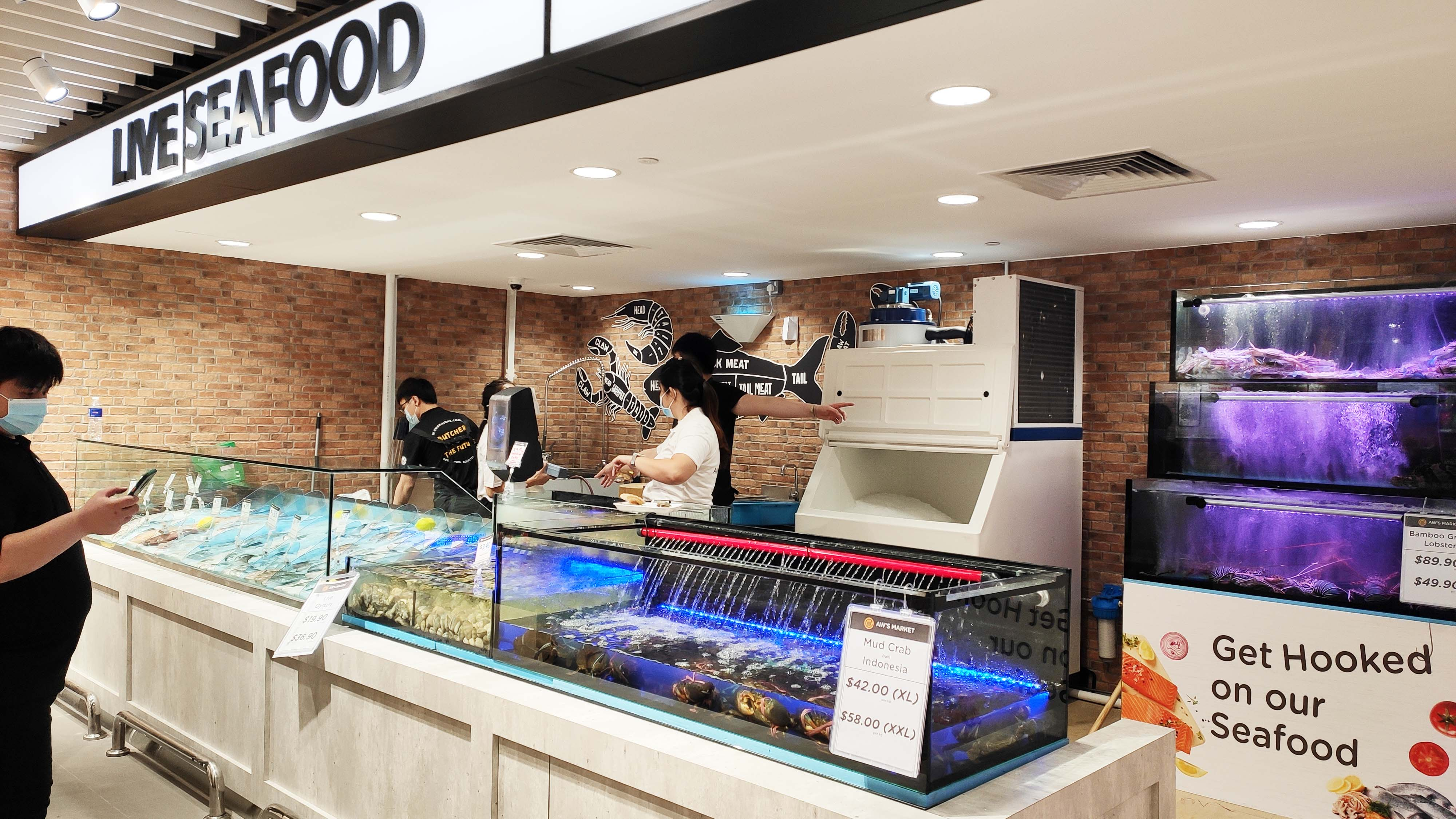 Aw's Market Live Seafood tanks with fish lobsters crabs at Westgate